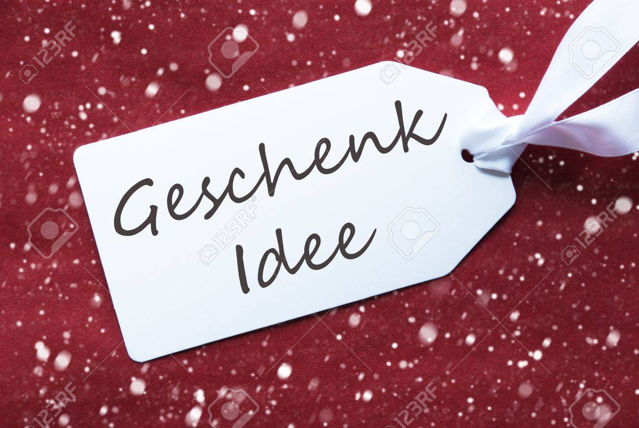german text geschenk idee means t idea one white label on a red textured background tag with ribb