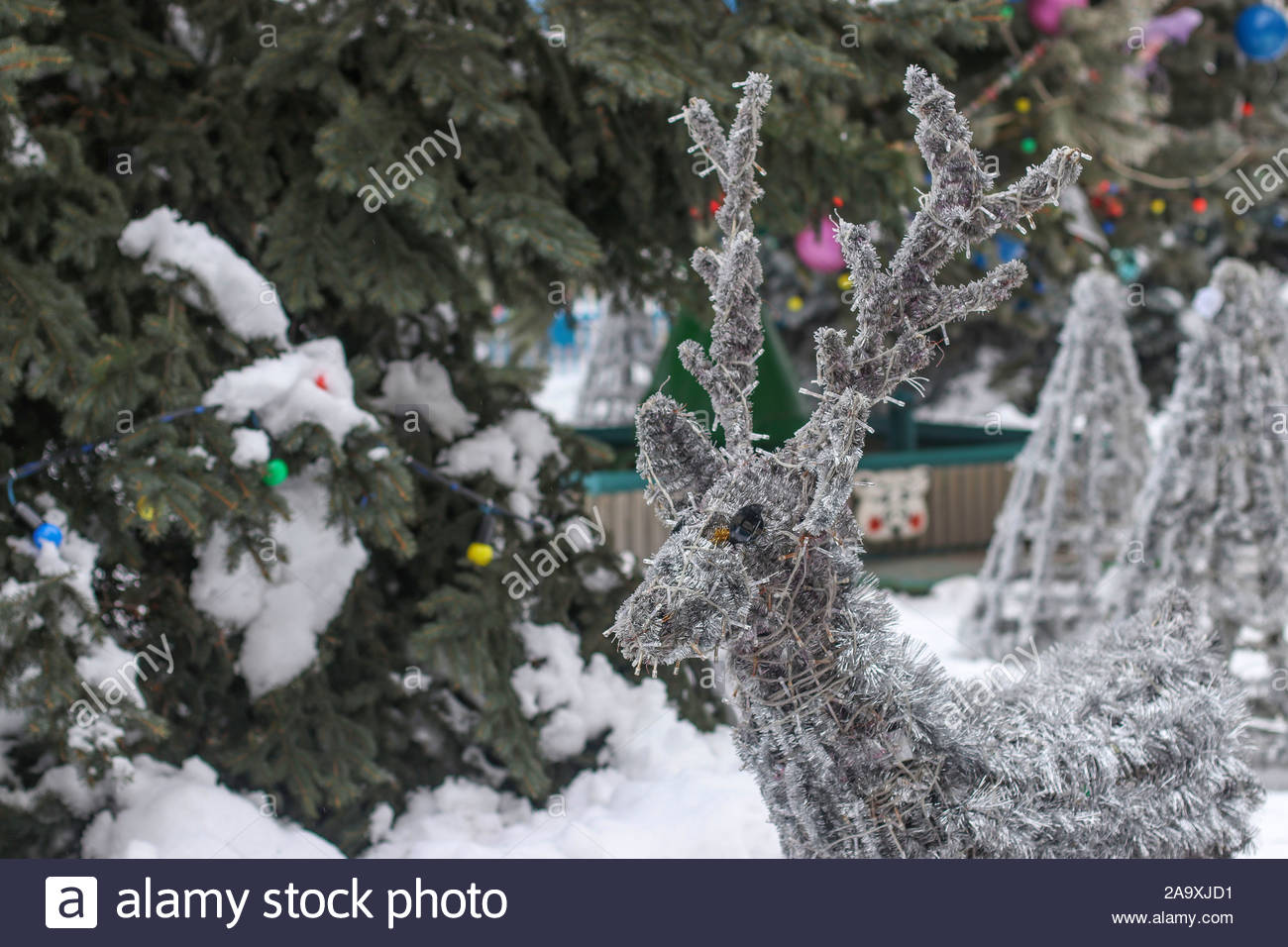 silver deer from shiny garlands in outdoor park design of a recreation area for children 2A9XJD1