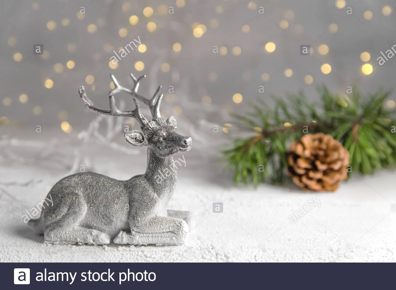 christmas new years eve silver deer against the lights spruce branch fairy forest 2AC61PP