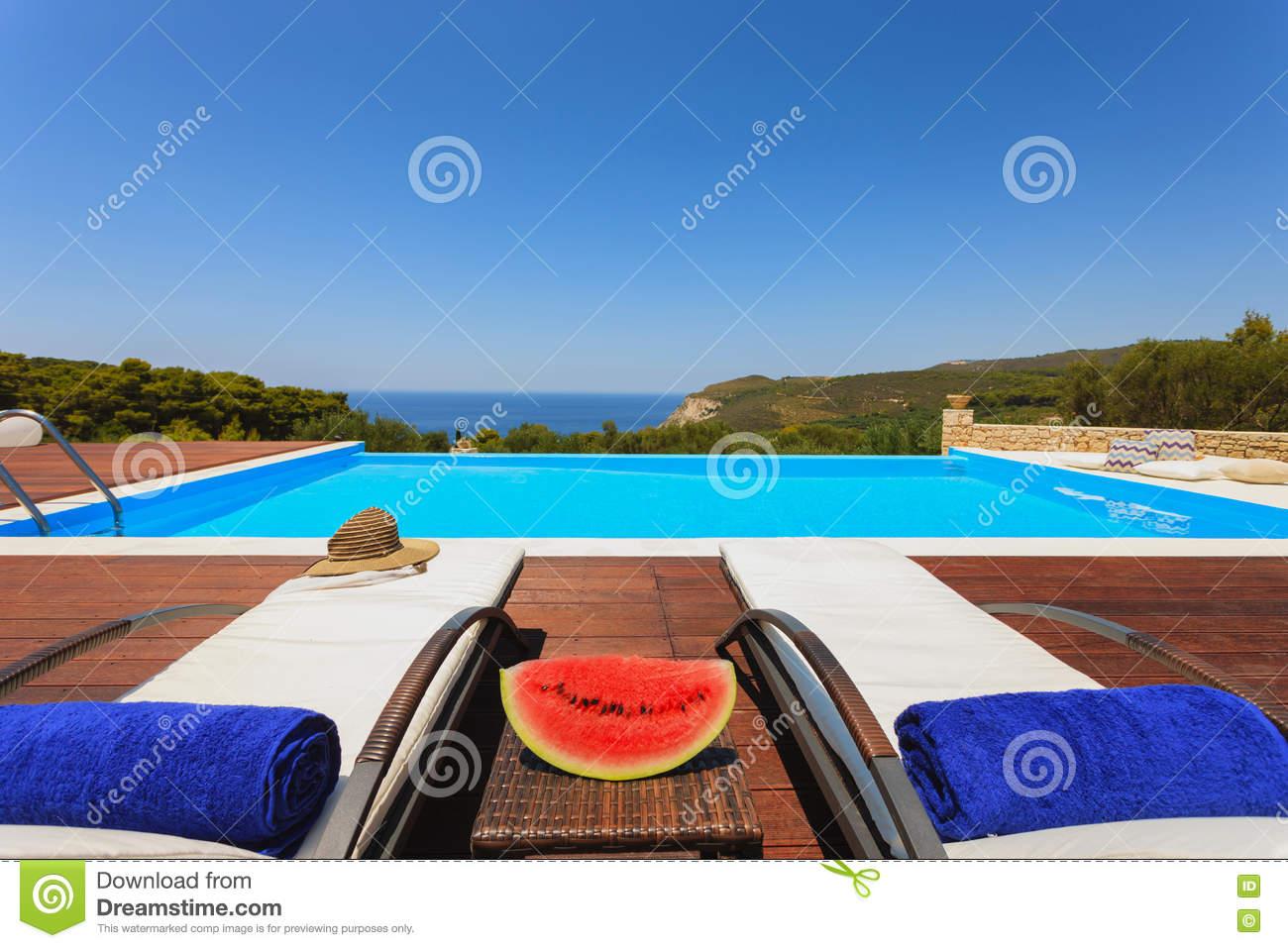 big luxury pool decoration sun beds summer resort