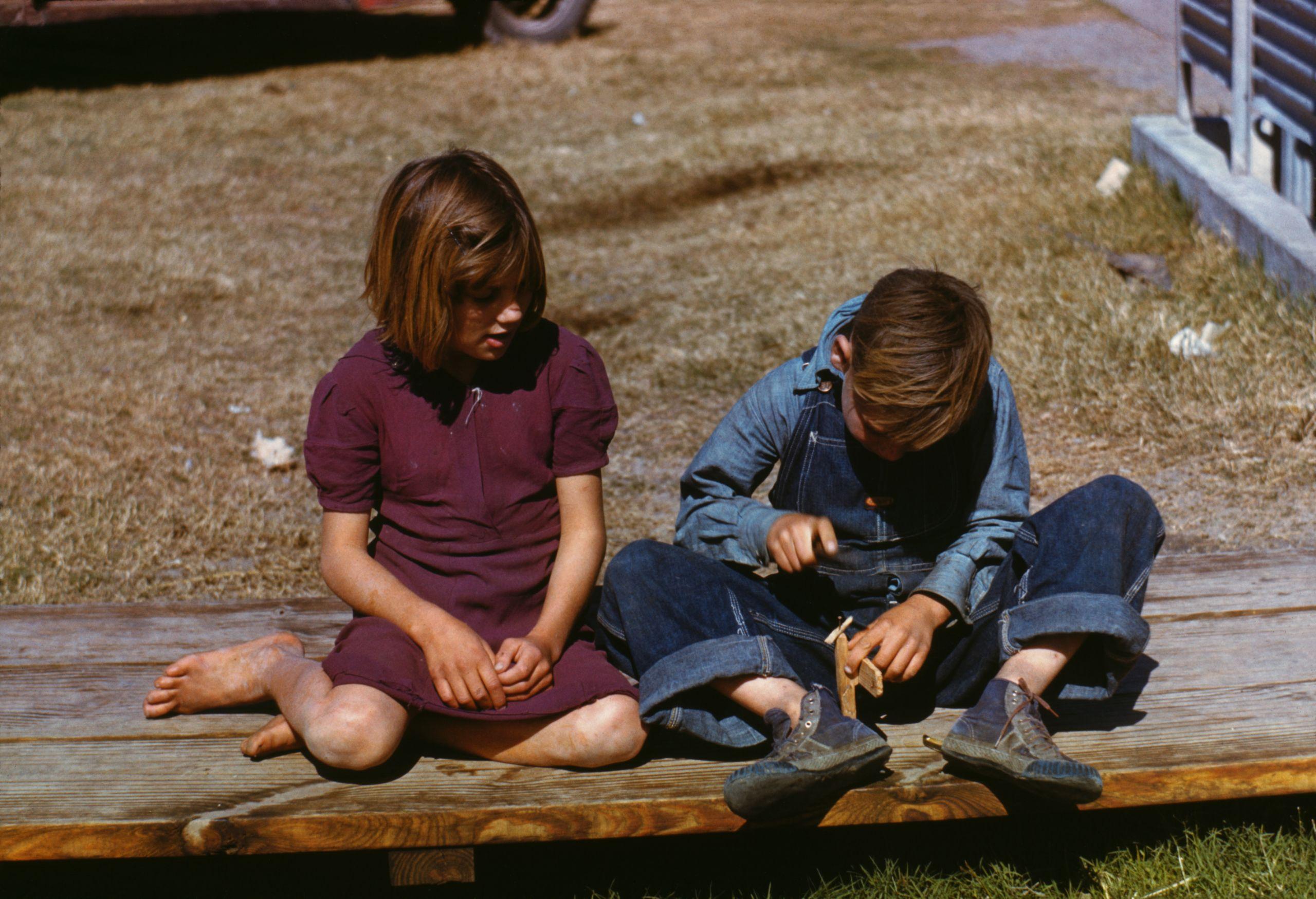 Arthur Rothstein Boy building a model airplane as girl watches FSA camp Robstown Texas 1942