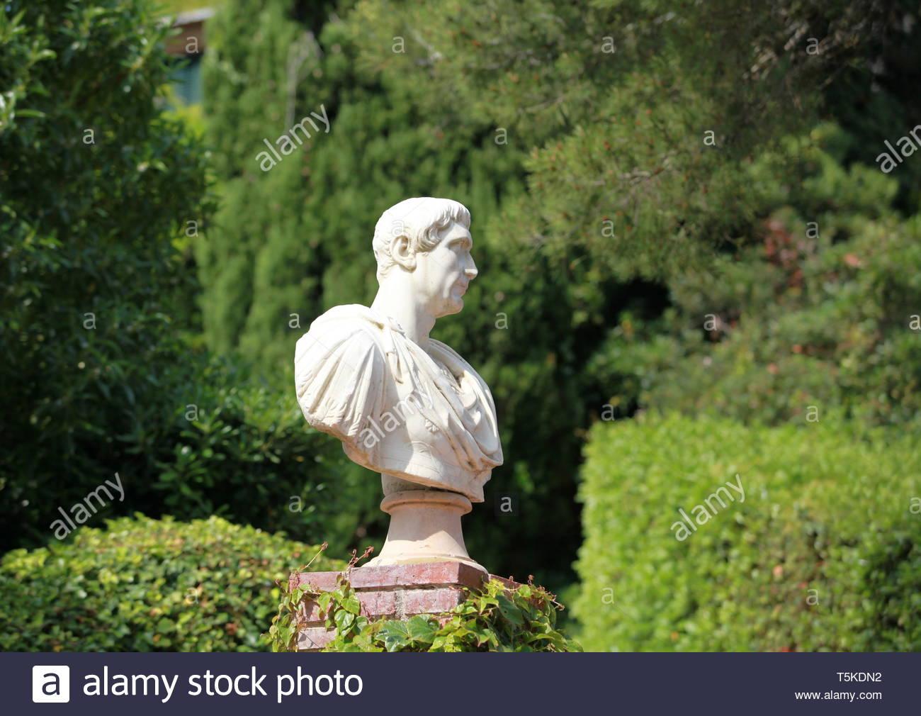 antique caesar bust in summer garden T5KDN2