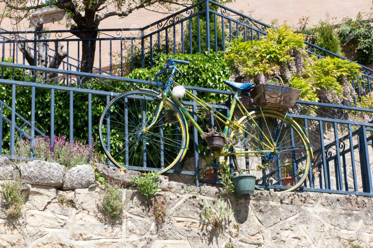 green garden deco bike with flower pots