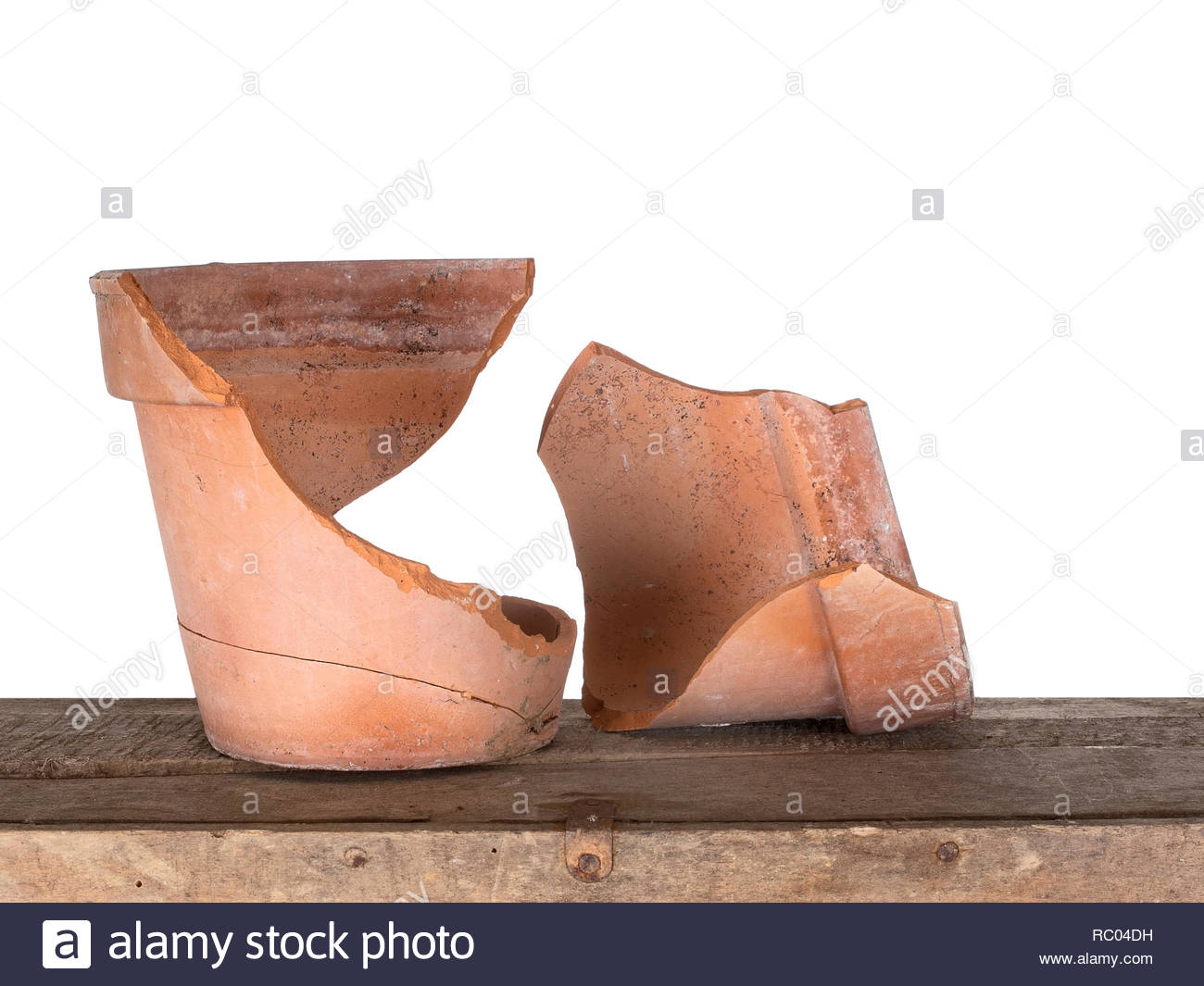 a broken terracotta flowerpot on old box isolated on white bhind frost damage RC04DH