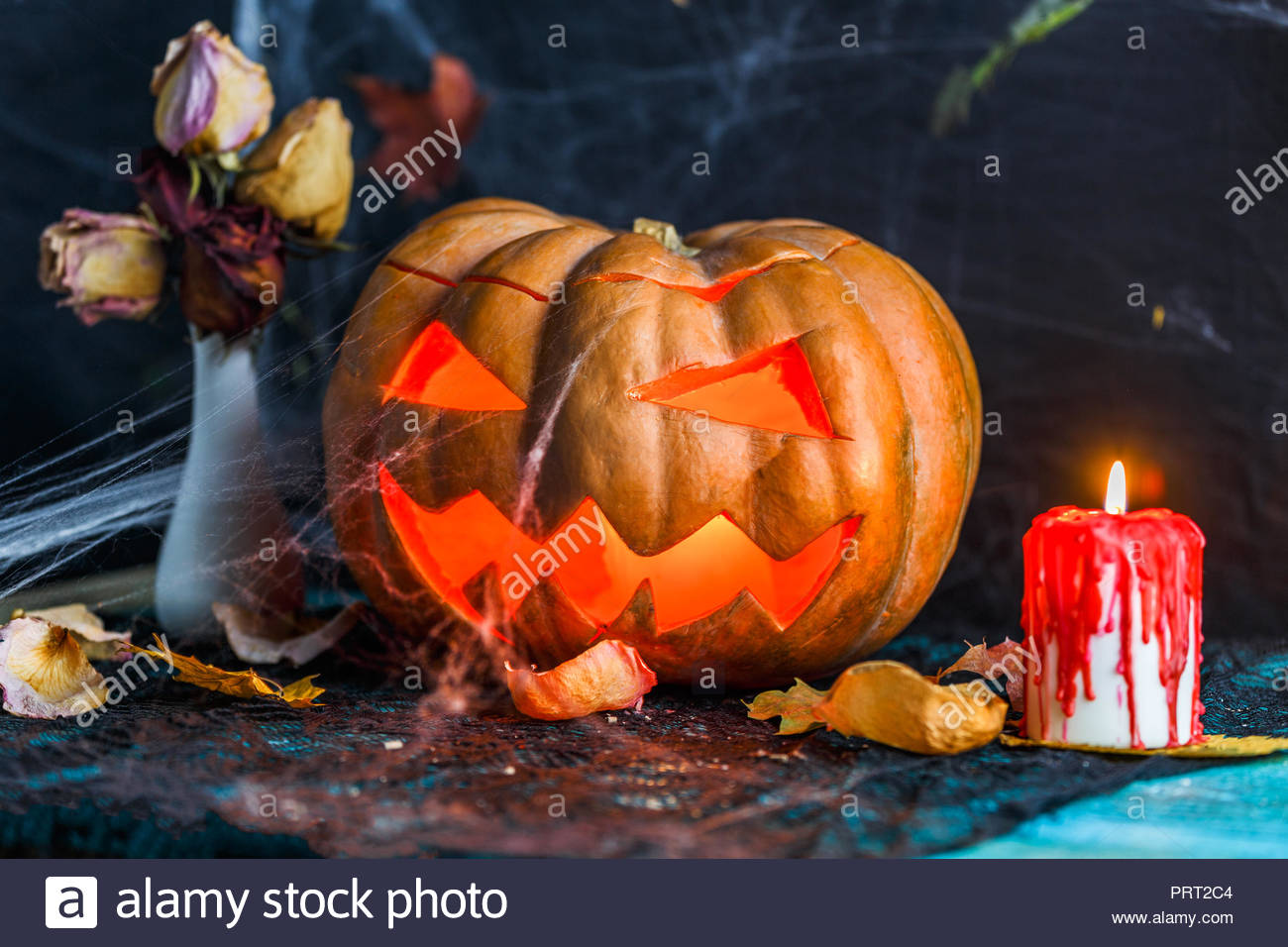 halloween picture of table with pumpkin burning candle PRT2C4