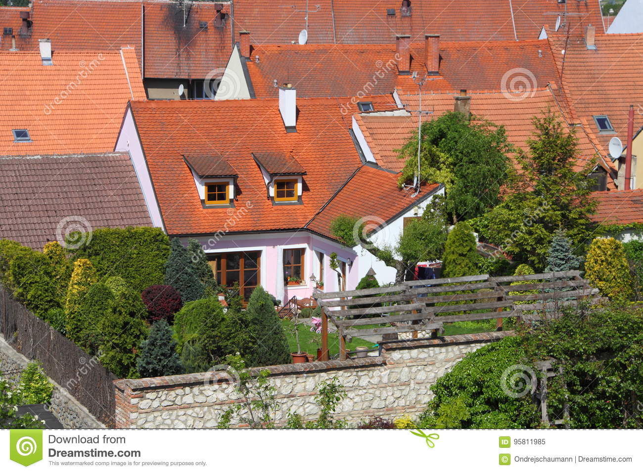 detail od small red roofed house tiny garden roof above