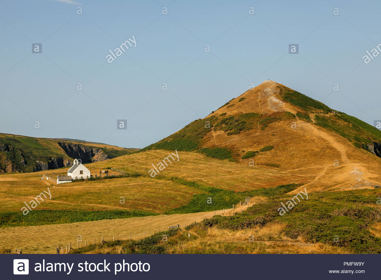 the historic chapel the church of the holy cross eglwys y grog welsh at mwnt in south ceredigion wales uk PMFW9Y
