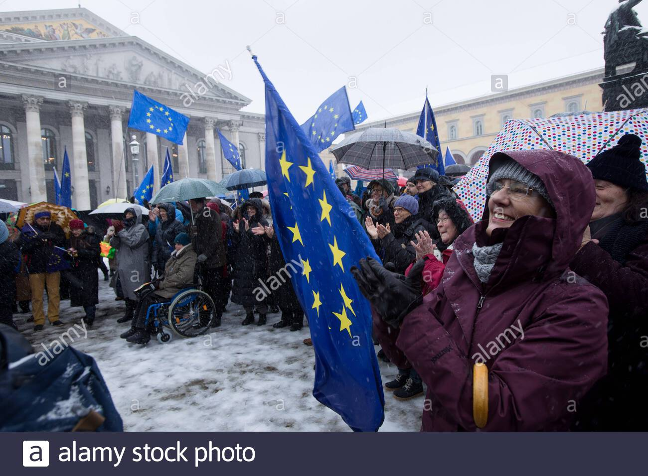 demonstration of the pro european citizens movement pulse of europe in the snowstorm on munichs max joseph platz automated translation 2ABKJXT