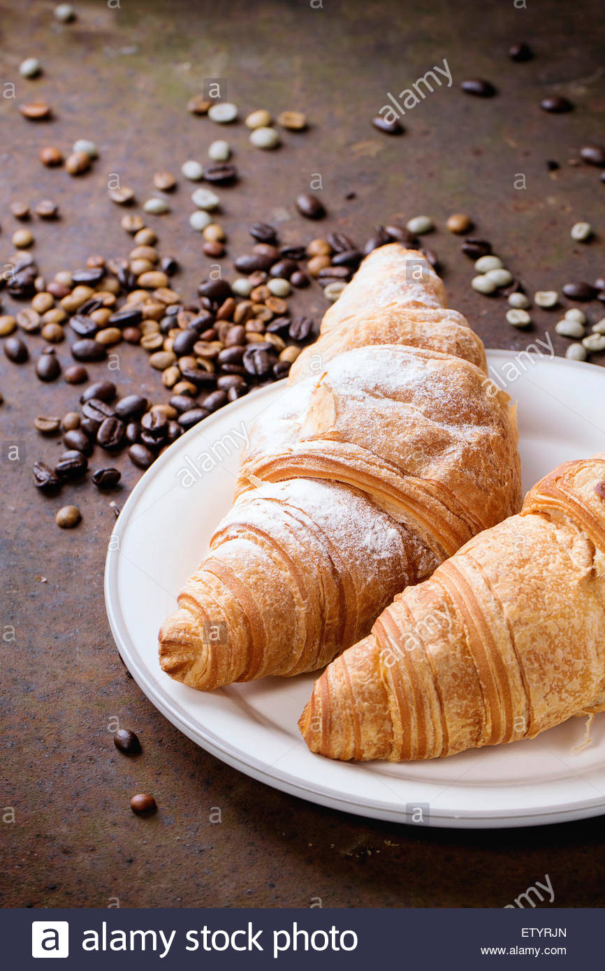 plate with two fresh baked croissants with heap od roasted and unroasted ETYRJN