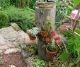 Rostkunst Für Den Garten Frisch Gartenarbeit Ideen Baumstamm Als Blumenständer
