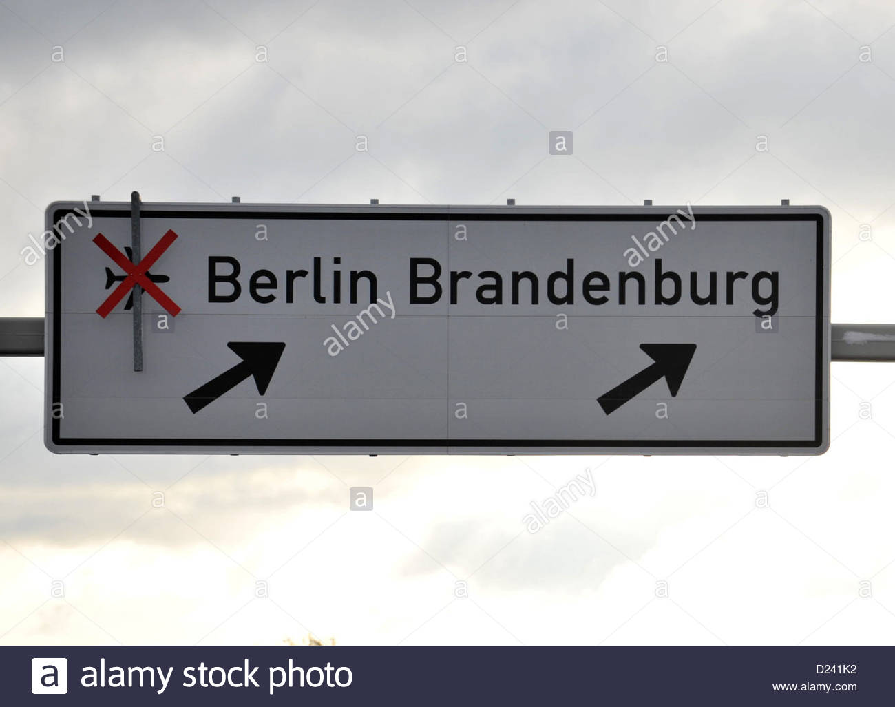 view od a sign board at an access road of berlin brandenburg airport D241K2