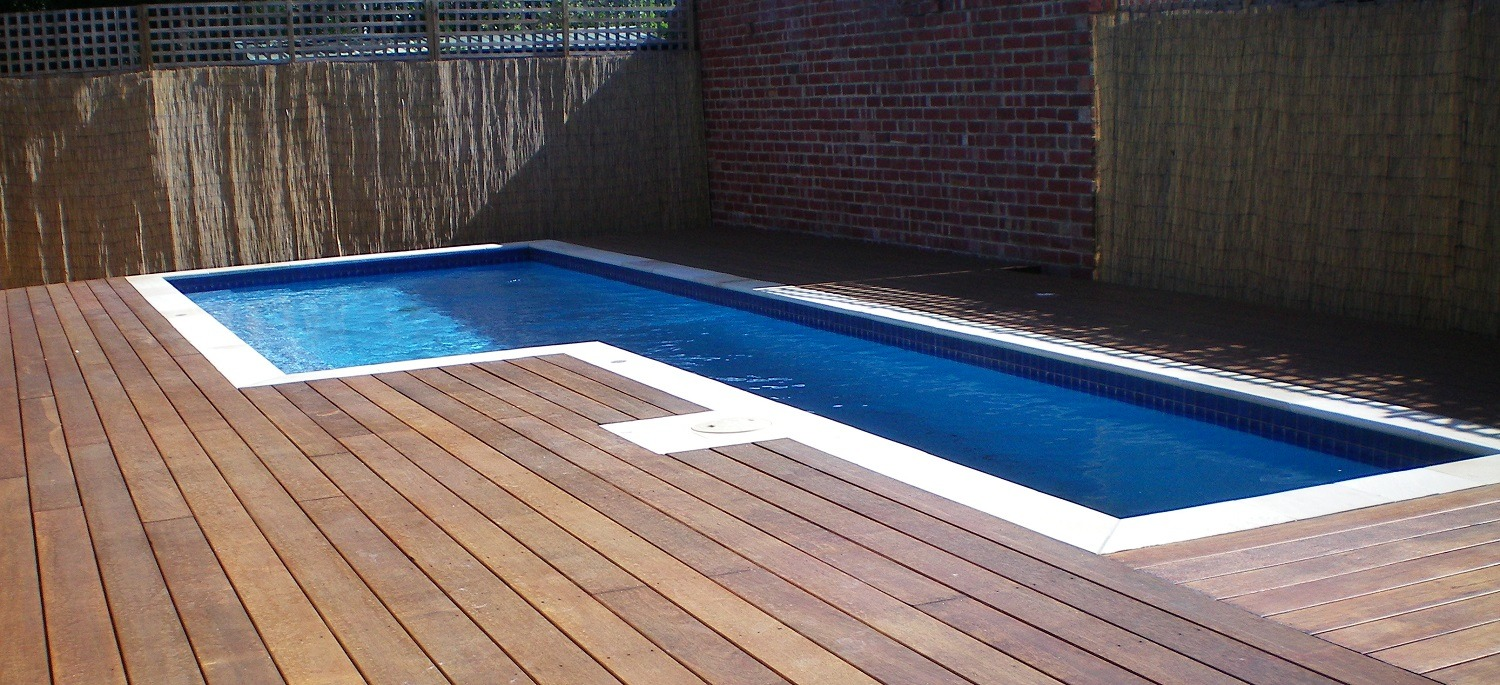 above ground pool with decking featured