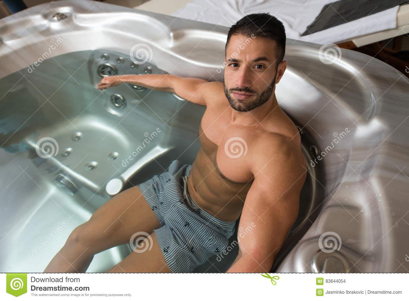 relaxing hot tube jacuzzi wellness spa man tub whirlpool indoors luxury resort spa retreat