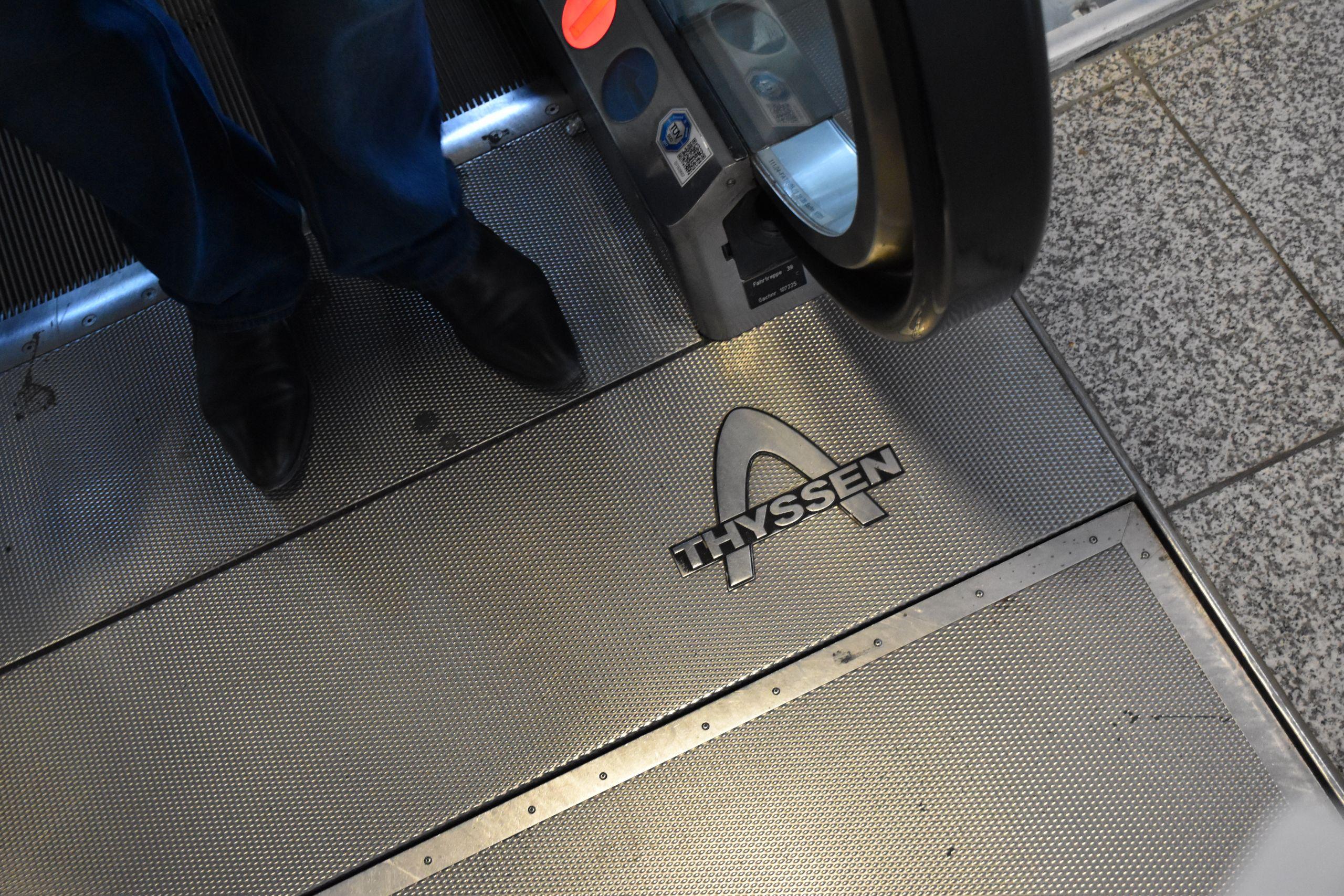 Thyssen logo on its escalator at Munich Airport