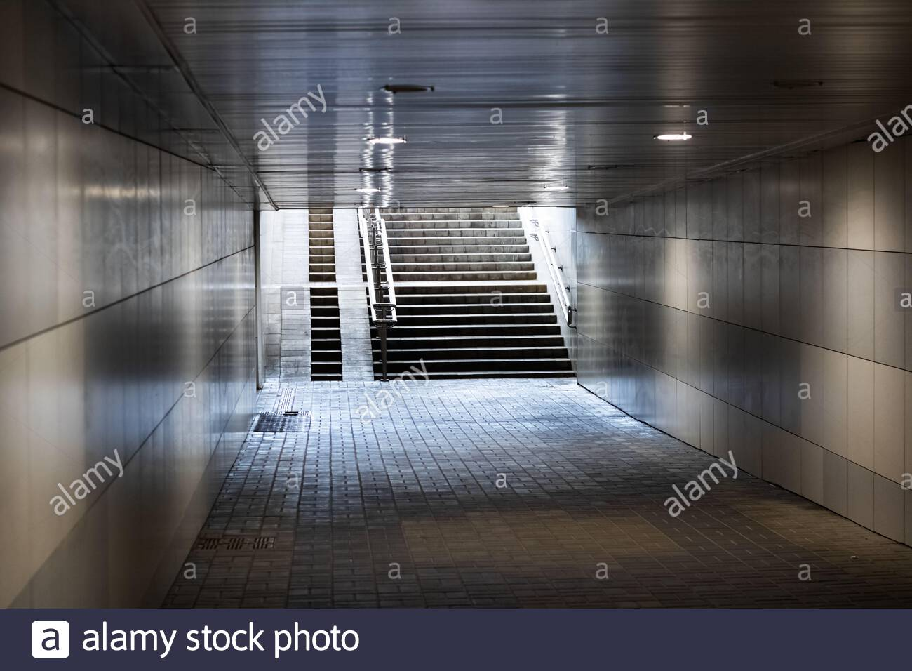 exit tunnel underpass and stairs in sunlight 2ATP5J4