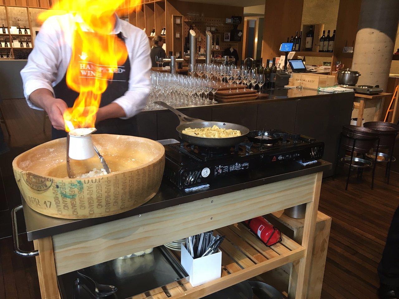flaming cheese wheel